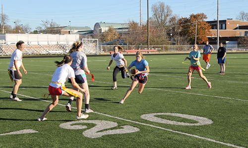 Students playing flag football.