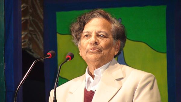 Dr. Rabindra Roy speaking.