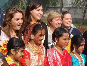 Group posing in front of the Hem Sheela School.