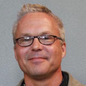 Portrait of Greg Ojakangas.