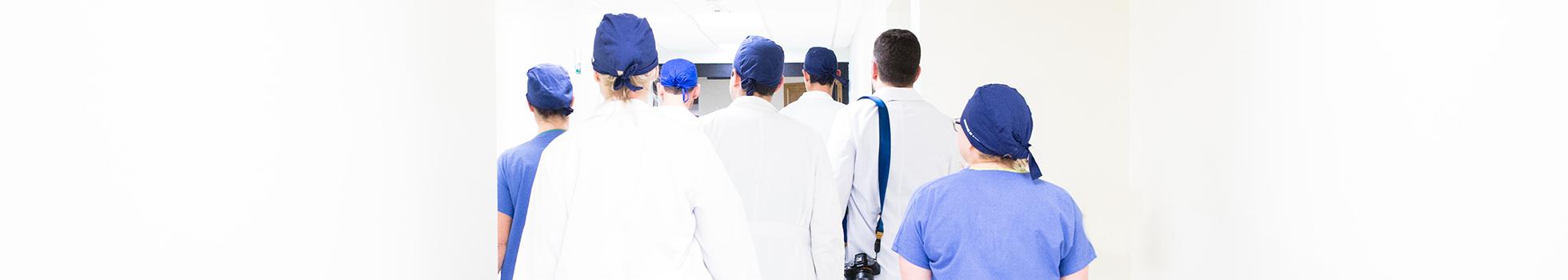 Doctors walking down hallway.