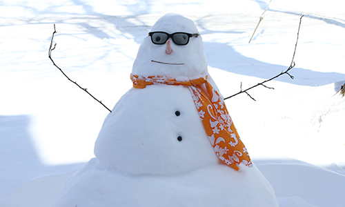 A snowman with sunglasses.