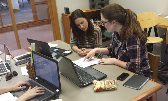 Students working on homework together.