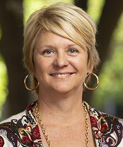 Portrait of Beth Nation.